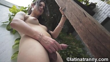 Transgender Nikki Montero by the pool wanking and pissing on the tree